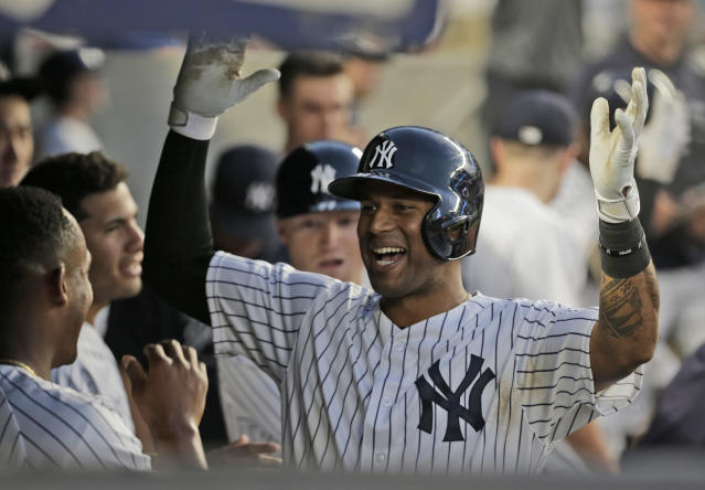 New York Yankees' Aaron Hicks celebrates his two-run home run in the dugout during the fifth inning of a baseball game against the Seattle Mariners at Yankee Stadium Tuesday, June 19, 2018, in New York. (AP Photo/Seth Wenig)