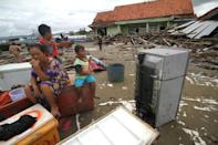 Survivors from Sumur on Java island returned to salvage items from destroyed or damaged homes
