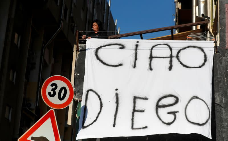 People mourn the death of Argentine soccer legend Diego Maradona, in Naples