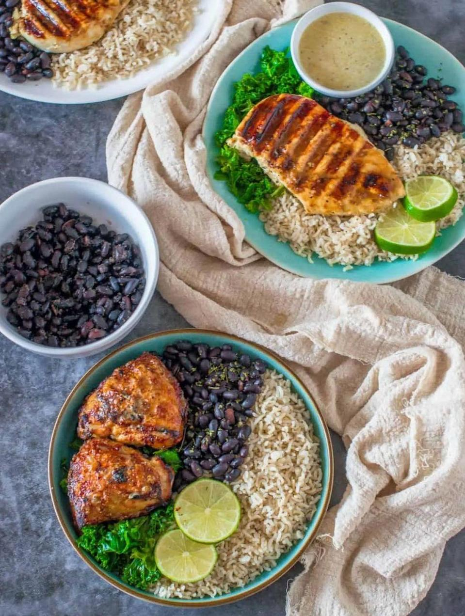 """<p>Serve lean chicken breasts that have been marinated in tangy mojo sauce with stewed black beans and healthy brown rice. <strong><br><br></strong></p><p><strong>Get the recipe at <a href=""""https://thatgirlcookshealthy.com/cuban-mojo-chicken-recipe/"""" rel=""""nofollow noopener"""" target=""""_blank"""" data-ylk=""""slk:That Girl Cooks Healthy"""" class=""""link rapid-noclick-resp"""">That Girl Cooks Healthy</a>.</strong></p>"""