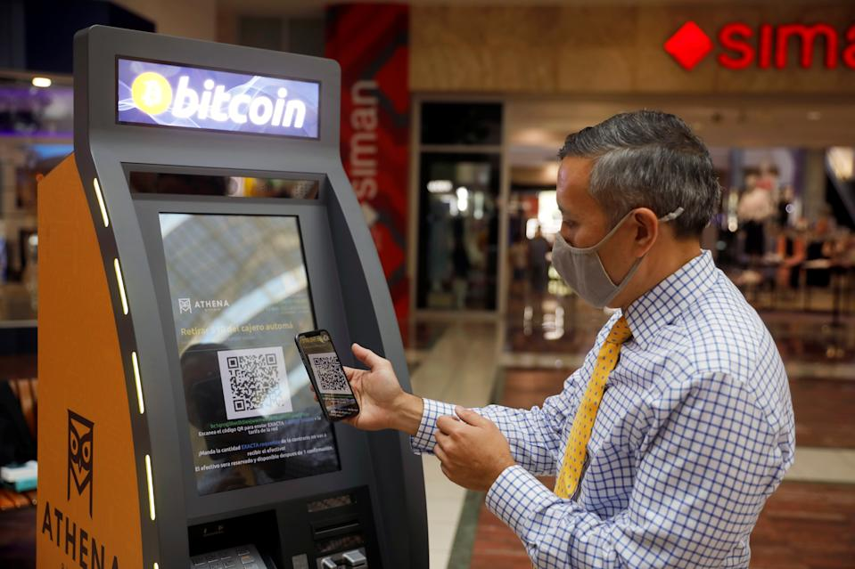 Eric Gravengaard, CEO of Athena Bitcoin Inc., shows the use of an ATM prior to a news conference during the presentation of a Bitcoin ATM in San Salvador, El Salvador June 24, 2021. REUTERS/Jose Cabezas