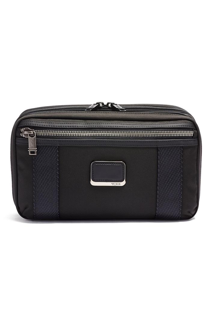 """This expandable toiletry bag from fan-favorite travel brand Tumi is water resistant and has loads of pockets to make sure all his essentials stay organized. $175, Nordstrom. <a href=""""https://www.nordstrom.com/s/tumi-alpha-bravo-reno-travel-kit-with-expansion/5535673"""" rel=""""nofollow noopener"""" target=""""_blank"""" data-ylk=""""slk:Get it now!"""" class=""""link rapid-noclick-resp"""">Get it now!</a>"""