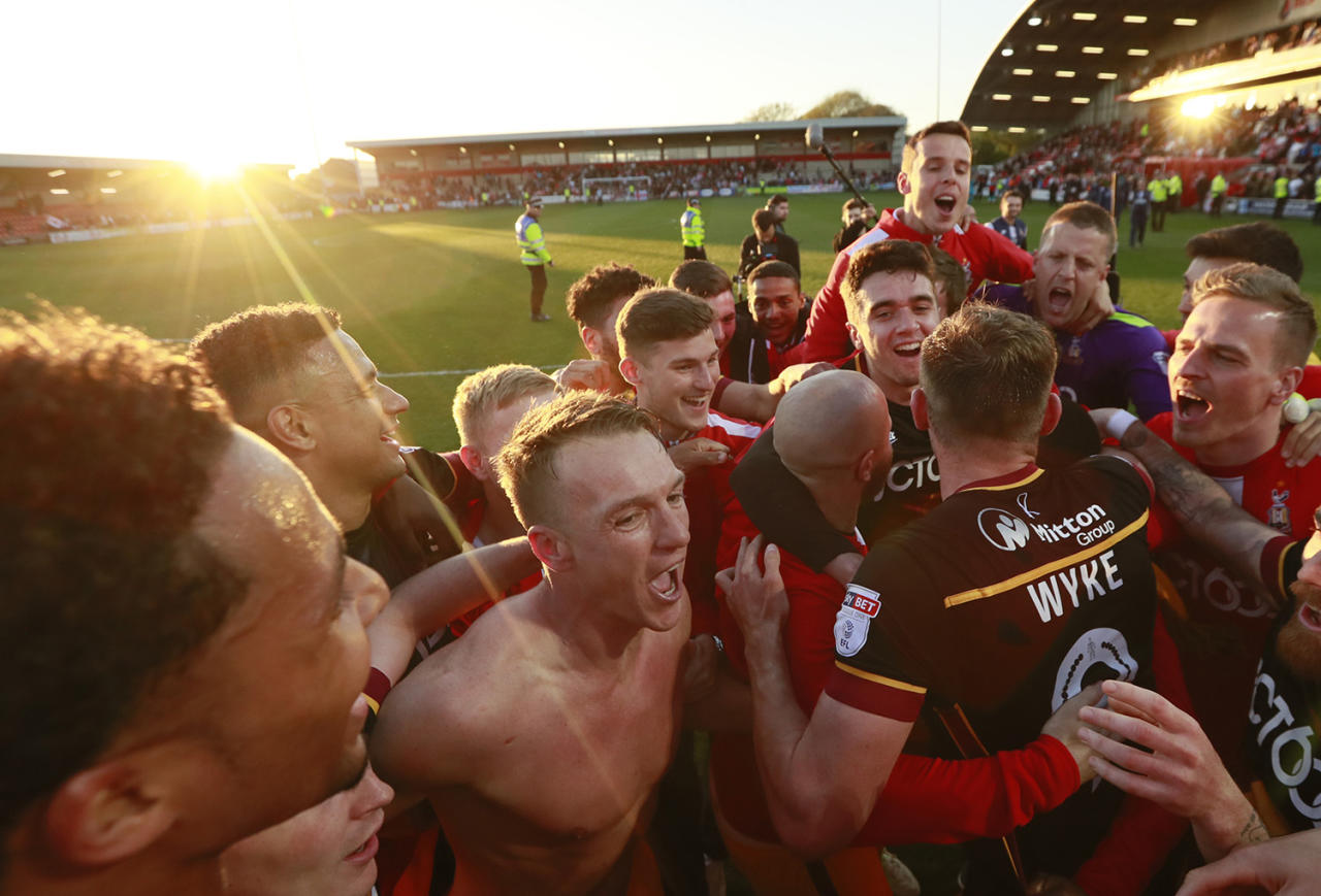<p>Bradford City players celebrate after a match against Fleetwood Town during the Sky Bet League One playoff semifinal at Highbury Stadium in Fleetwood, England, May 7, 2017. (Jason Cairnduff/Action Images/Reuters) </p>
