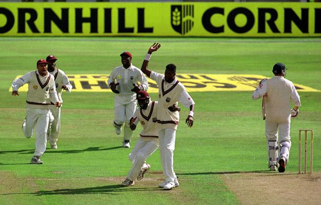 17  Aug 2000: Mike Atherton of England walks off as Curtly Ambrose celebrates his 400th wicket during the first day of the England v West Indies Fourth Cornhill Test Match at Headingley, Leeds. Mandatory Credit: Michael Steele/ALLSPORT