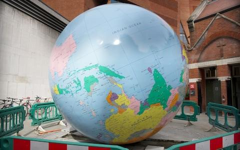 The globe sculpture by Mark Wallinger at LSE has been defaced to show Taiwan as part of China - Credit: Eddie Mulholland for The Telegraph