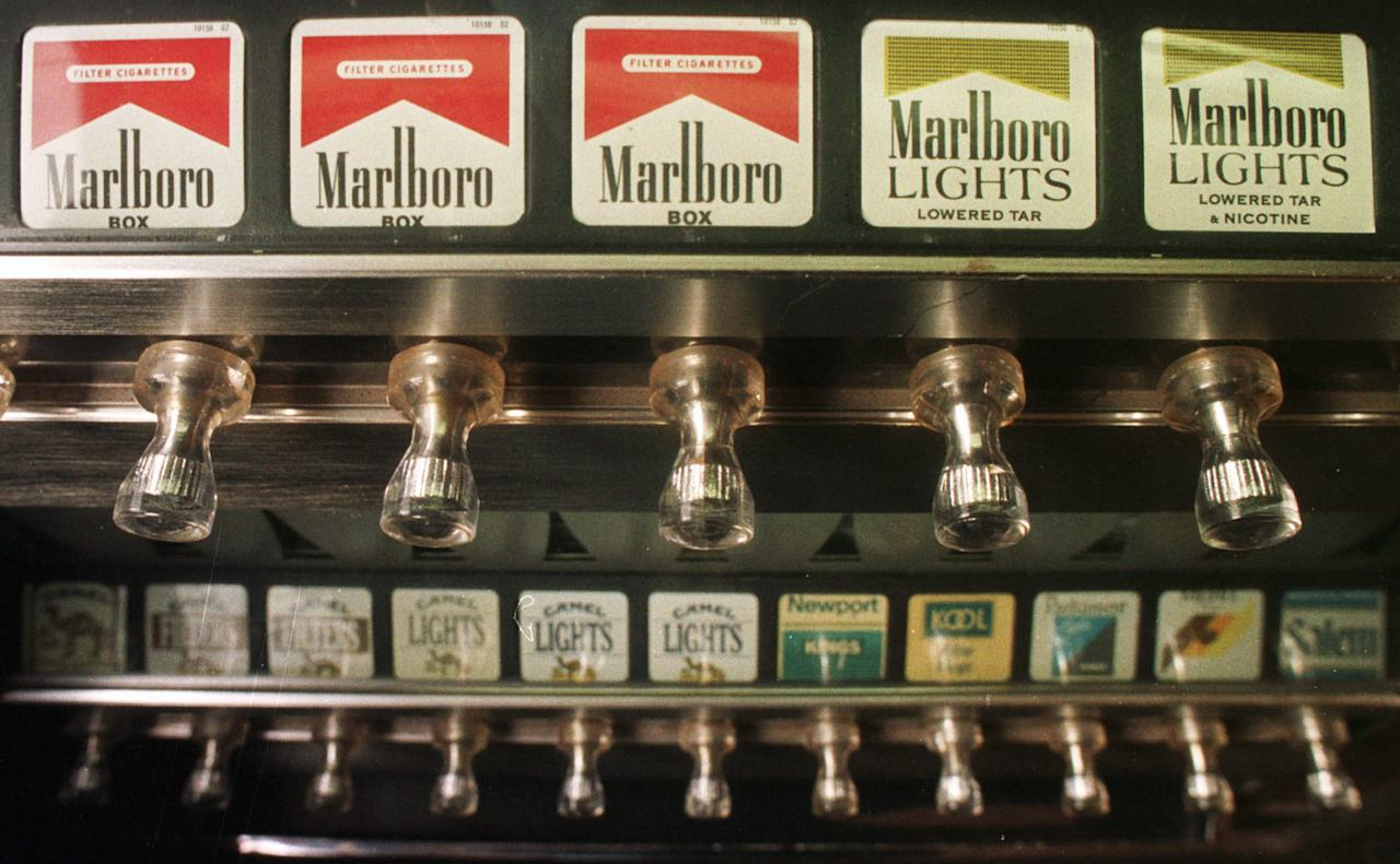 FILE - This Monday, Oct. 13, 1997 file photo shows a cigarette vending machine in a bar in Montpelier, Vt. A law passed by the Legislature banned all cigarette vending machines in the state as of August 28, 1997, but Vermont Attorney General William Sorrell ruled that enforcement of the law would begin in March 1998. On Jan. 11, 1964, U.S. Surgeon General Luther Terry released an emphatic and authoritative report that said smoking causes illness and death - and the government should do something about it. (AP Photo/Toby Talbot)