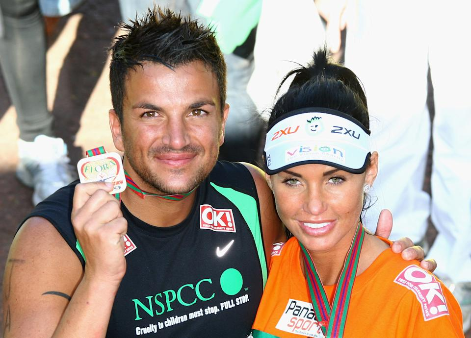 LONDON - APRIL 26:  Katie Price and Peter Andre pose after they completed the 2009 Flora London Marathon on April 26, 2009 in London, England.  (Photo by Gareth Cattermole/Getty Images)