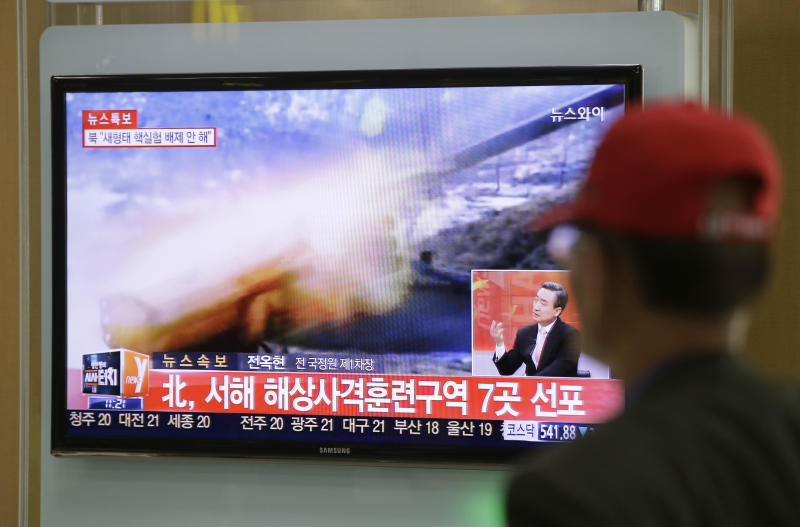 """A man watches a television news program reporting about North Korea's plan to conduct live-fire drills, at a Seoul train station in Seoul, South Korea, Monday, March 31, 2014. South Korea said North Korea has announced plans to conduct live-fire drills near the rivals' disputed western sea boundary. Seoul's Defense Ministry said North Korea says it will conduct firing drills in seven areas north of the sea boundary. Seoul responded that it will strongly react if provoked. The writing reads """"North, Firing drills in seven areas western sea."""" (AP Photo/Lee Jin-man)"""