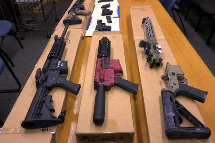 """FILE - This Nov. 27, 2019 file photo shows """"ghost guns"""" on display at the headquarters of the San Francisco Police Department in San Francisco. Chicago and three other cities sued the federal government Wednesday, Aug. 26, 2020, to stop the proliferation of what are advertised as easy-to-assemble """"ghost guns"""" that require no serial numbers or background checks. (AP Photo/Haven Daley, FIle)"""