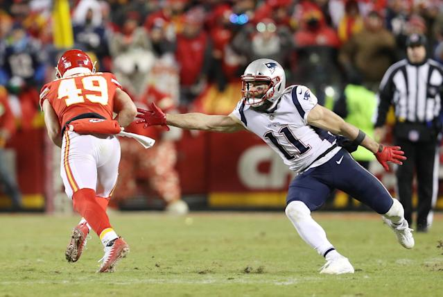 Julian Edelman tries desperately to tackle Chiefs safety Daniel Sorensen after his interception.