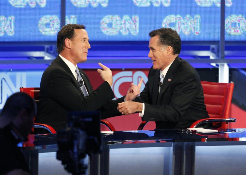 Republican presidential candidates, former Pennsylvania Sen. Rick Santorum, left, and former Massachusetts Gov. Mitt Romney talk following a Republican presidential debate Wednesday, Feb. 22, 2012, in Mesa, Ariz. (AP Photo/The Arizona Republic, Nick Oza) MARICOPA COUNTY OUT; MAGS OUT; NO SALES