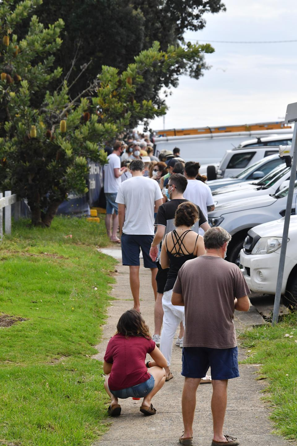 People line up for Covid-19 testing at Mona Vale Hospital's walk-in clinic in Sydney