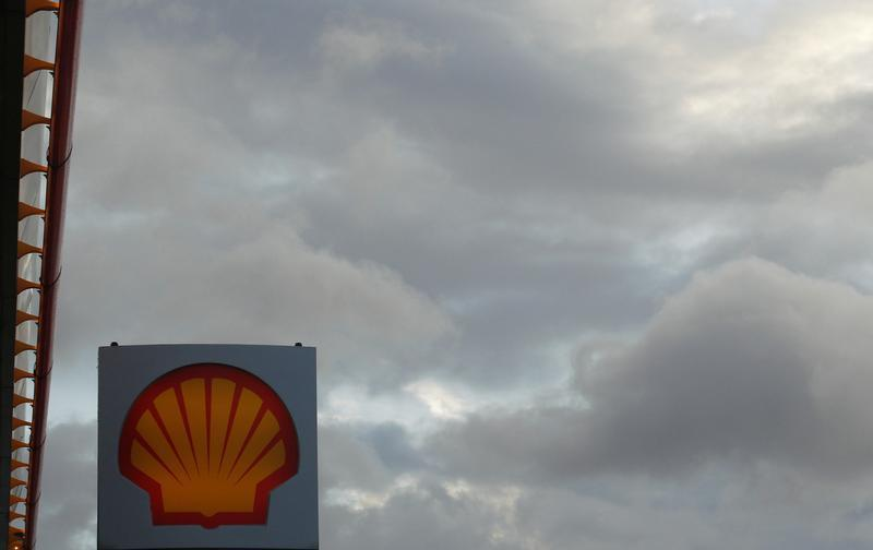A Shell logo is seen at a petrol station in London