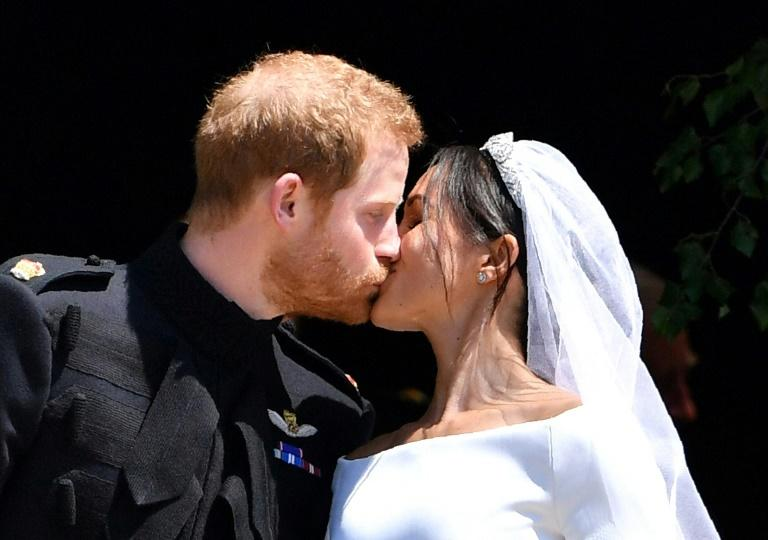 Britain's Prince Harry, Duke of Sussex, kisses his wife Meghan, Duchess of Sussex, as they leave St George's Chapel, Windsor Castle, after their wedding ceremony in May 2018 -- the couple is now planning to live most of the time in North America