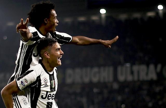 Juventus' forward Paulo Dybala (down) has been tipped for success by rival Diego Perotti (AFP Photo/MARCO BERTORELLO)