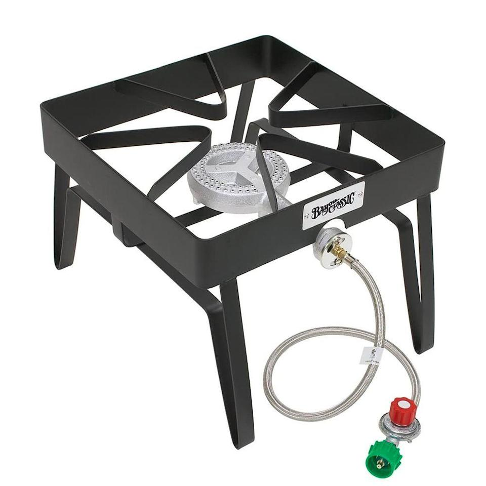 "<p><strong>Bayou Classic</strong></p><p>amazon.com</p><p><strong>$67.04</strong></p><p><a href=""https://www.amazon.com/Bayou-Classic-Square-Patio-Stove/dp/B0009JXYQ4?tag=syn-yahoo-20&ascsubtag=%5Bartid%7C2089.g.34482972%5Bsrc%7Cyahoo-us"" rel=""nofollow noopener"" target=""_blank"" data-ylk=""slk:Shop Now"" class=""link rapid-noclick-resp"">Shop Now</a></p><p>We recommend pairing your pot with Bayou's single burner stove, which gets up to 55,000 BTUs. It stands 13 inches tall on four welded legs (other burners have just three), so you can ensure it'll keep stable — even when you have a heavy pot of oil resting atop it. The 6-inch cast-iron double-ring fry burner spreads the flame nice and wide, meaning it should heat your oil up in under 30 minutes.</p><p>The 16-inch-by-16-inch cooking surface provides ample room for any stockpot, and the 36-inch stainless braided hose is plenty long enough to connect to a neighboring propane tank. Lastly, the stove comes with an adjustable 10 PSI regulator to regulate the flow of fuel.</p>"