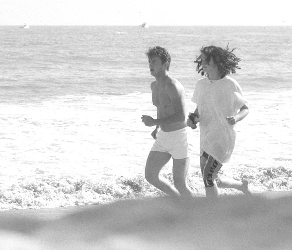 "<p>Madonna and Sean Penn jogging on the beach in Malibu, California.</p><p>Other celebrity visitors this year: <span class=""redactor-invisible-space"">Tom Cruise, Diane Keaton, Andy Warhol.<br></span></p>"
