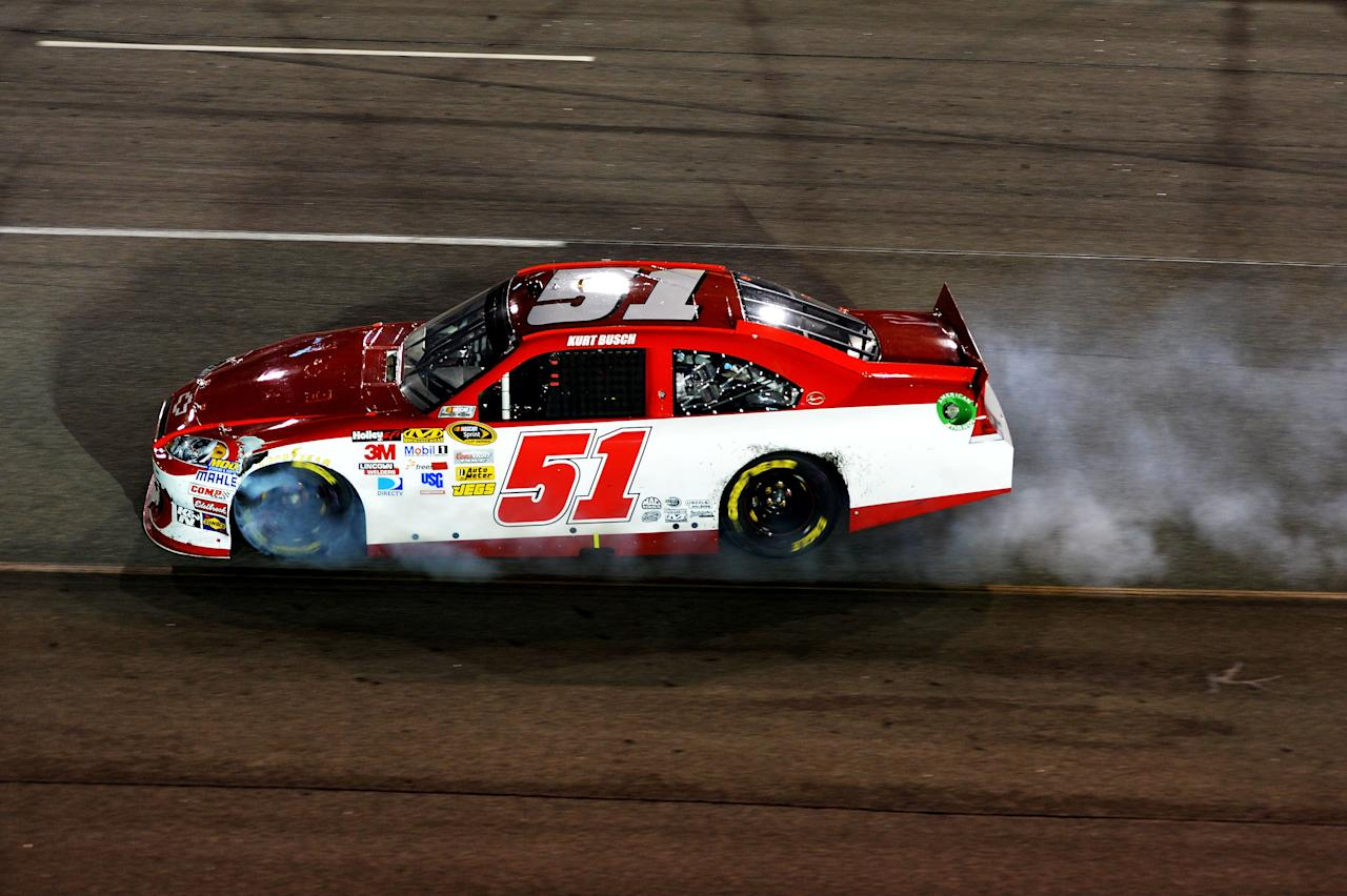 RICHMOND, VA - APRIL 28:  Kurt Busch, driver of the #51 Phoenix Construction Services Chevrolet, spins out after an incident in the NASCAR Sprint Cup Series Capital City 400 at Richmond International Raceway on April 28, 2012 in Richmond, Virginia.  (Photo by Drew Hallowell/Getty Images)