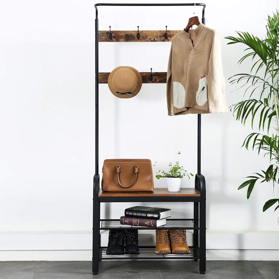"""<h3><a href=""""https://www.amazon.com/Sunnyglade-Vintage-Entryway-Furniture-Assembly/dp/B07JR9TNDY/ref=sr_1_2_sspa"""" rel=""""nofollow noopener"""" target=""""_blank"""" data-ylk=""""slk:Wood & Metal Hall Tree"""" class=""""link rapid-noclick-resp"""">Wood & Metal Hall Tree</a></h3><br>You can still create a smart entryway storage system when a coat closet is nonexistent — just slide this wood and metal hall tree unit up against the wall to keep your indoor-outdoor essentials easily organized.<br><br><strong>Sunnyglade</strong> Wood & Metal Hall Tree, $, available at <a href=""""https://www.amazon.com/Sunnyglade-Vintage-Entryway-Furniture-Assembly/dp/B07JR9TNDY/ref=sr_1_2_sspa"""" rel=""""nofollow noopener"""" target=""""_blank"""" data-ylk=""""slk:Amazon"""" class=""""link rapid-noclick-resp"""">Amazon</a>"""