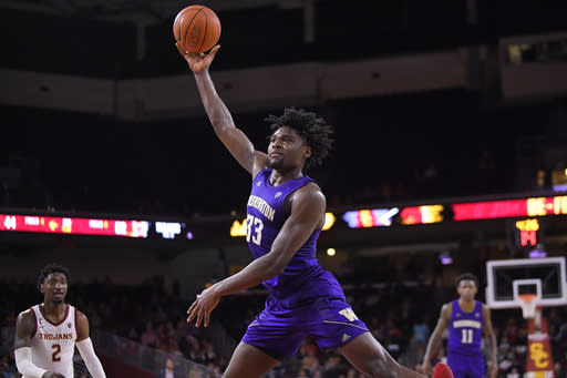 FILE - In this Feb. 13, 2020, file photo, Washington forward Isaiah Stewart, center, shoots as Southern California guard Jonah Mathews, left, watches during the second half of an NCAA college basketball game in Los Angeles. Stewart was selected by the Portland Trail Blazers in the NBA draft Wednesday, Nov. 18, 2020.(AP Photo/Mark J. Terrill, File)