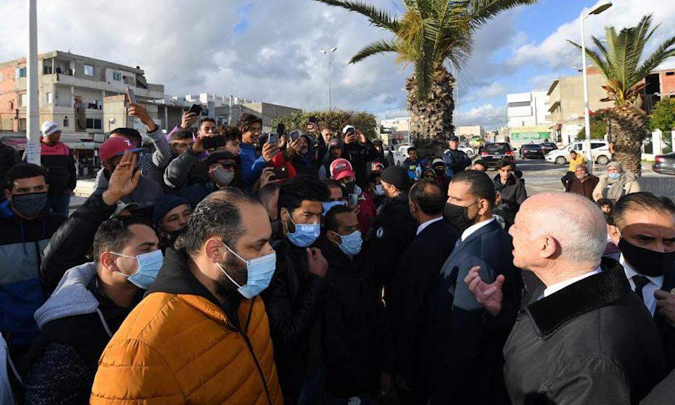 Tunisian President Kais Saied, right, calls for calm in Tunis, 18 January 2021.