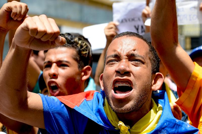 Venezuela's economic collapse has led to shortages, crime, public protests and political unrest in the once-rich OPEC mainstay (AFP Photo/Federico Parra)