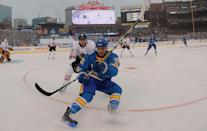 <p>ST. LOUIS, MO – JANUARY 2: Robby Fabbri #15 of the St. Louis Blues and Trevor van Riemsdyk #57 of the Chicago Blackhawks chase the puck during the 2017 Bridgestone NHL Winter Classic at Busch Stadium on January 2, 2017 in St. Louis, Missouri. (Photo by Dilip Vishwanat/Getty Images) </p>