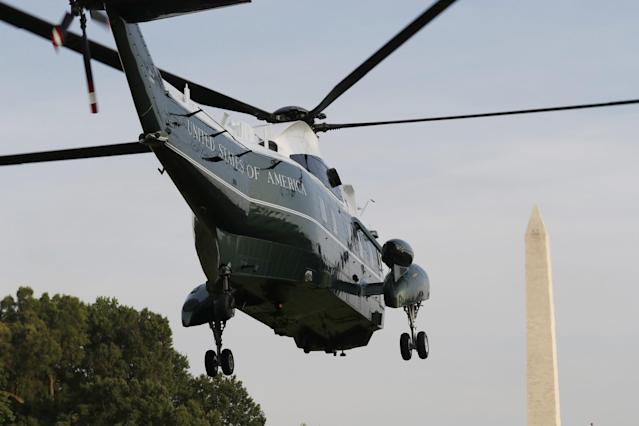 <p>Marine One, with President Donald Trump, and First Lady Melania Trump aboard, lifts off from the South Lawn of the White House, Wednesday, July 12, 2017, in Washington. (Photo: Alex Brandon/AP) </p>