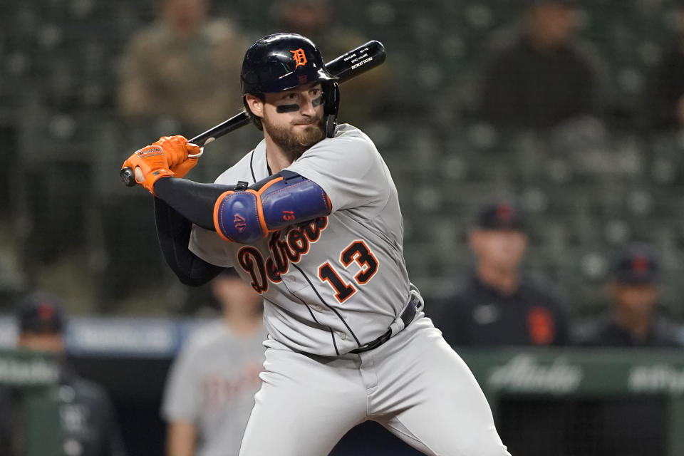 Detroit Tigers' Eric Haase begins his swing on a solo home run during the ninth inning of a baseball game against the Seattle Mariners, Monday, May 17, 2021, in Seattle. (AP Photo/Ted S. Warren)