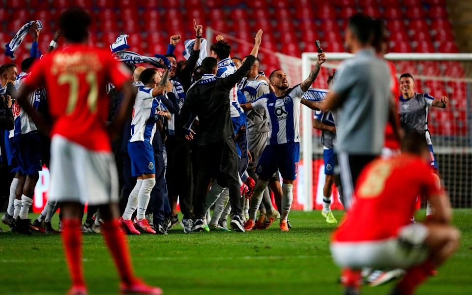 FC Porto's Brazilian defender Alex Telles (2R) celebrates with teammates after winning the 'Taca de Portugal' (Portugal's Cup) final football match between SL Benfica and FC Porto at the City Stadium of Coimbra on August 1, 2020 - AFP