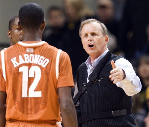 Texas head coach Rick Barnes, right, talks with Myck Kabongo during a time out in the first half of an NCAA college basketball game against Missouri Saturday, Jan. 14, 2012, in Columbia, Mo. (AP Photo/L.G. Patterson)