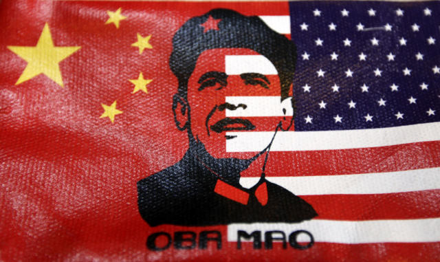 """The cover of a wallet bearing an image of U.S. President Barack Obama's face, in place of the usual image of China's late Chairman Mao Zedong, is pictured at a souvenir shop in Beijing, January 18, 2011. U.S. senators pressed Congress to get tough with China over """"manipulating"""" its currency in a riposte to Chinese President Hu Jintao, who said this week he would not accept U.S. arguments the yuan was undervalued. REUTERS/Jason Lee"""