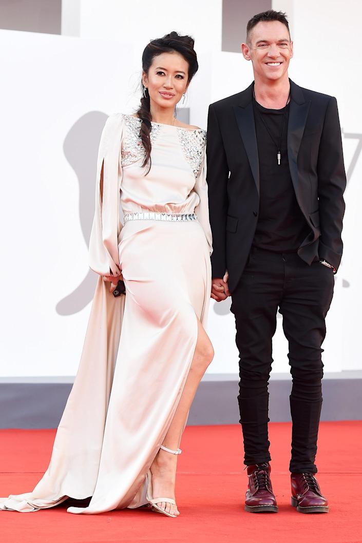 <p>Jonathan Rhys Meyers and wife Mara Lane hold hands at the red carpet premiere for the movie <em>Freaks Out</em> during the Venice International Film Festival in Italy on Sept. 8.</p>
