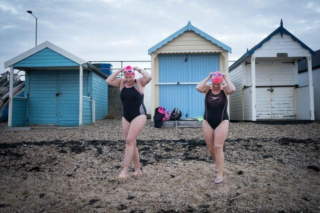 Swimmers take their daily dip in the Thames estuary at Thorpe Bay near Southend-on-Sea