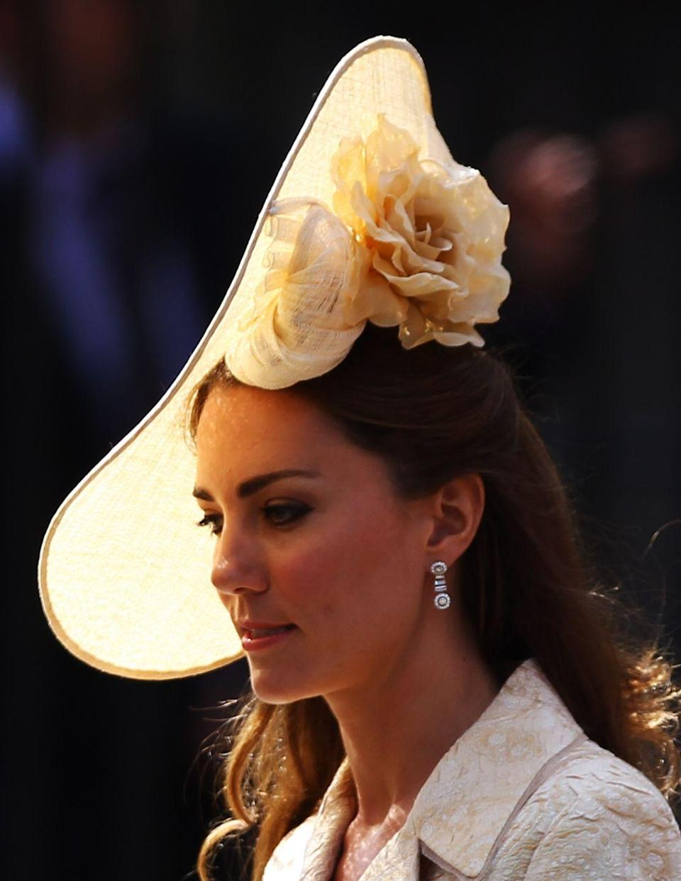 <p>Just a few months after her own nuptials, Duchess Kate wore a bespoke cream-colored fascinator by milliner Gina Foster to her cousin-in-law's wedding.</p>