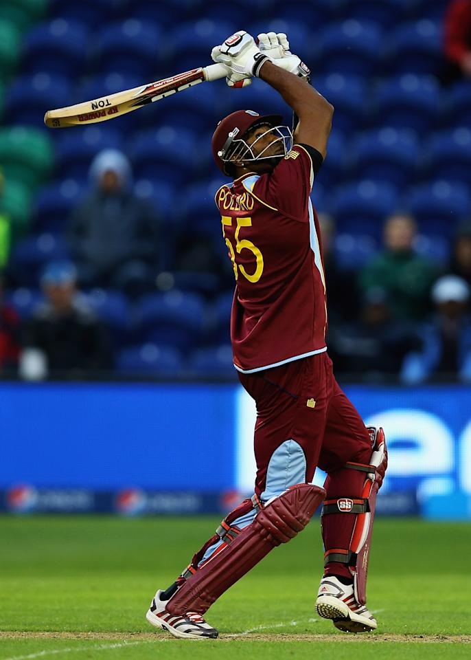 CARDIFF, WALES - JUNE 14:  Kieron Pollard of the West Indies hits the ball towards the boundary during the ICC Champions Trophy Group B match between West Indies and South Africa at SWALEC Stadium on June 14, 2013 in Cardiff, Wales.  (Photo by Matthew Lewis-ICC/ICC via Getty Images)
