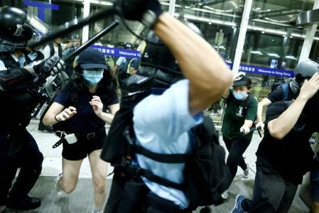 FILE PHOTO: Police clash with anti-government protesters at the airport in Hong Kong