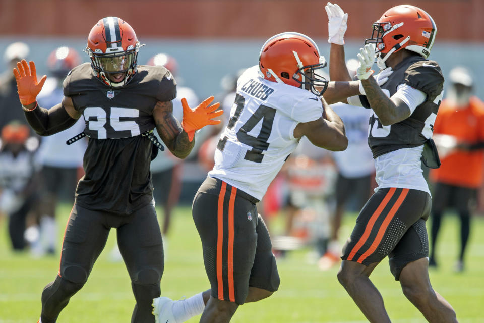 Cleveland Browns running back Nick Chubb (24) runs the ball against defensive back Greedy Williams (26) during an NFL football practice in Berea, Ohio, Wednesday, Aug. 4, 2021. (AP Photo/David Dermer)