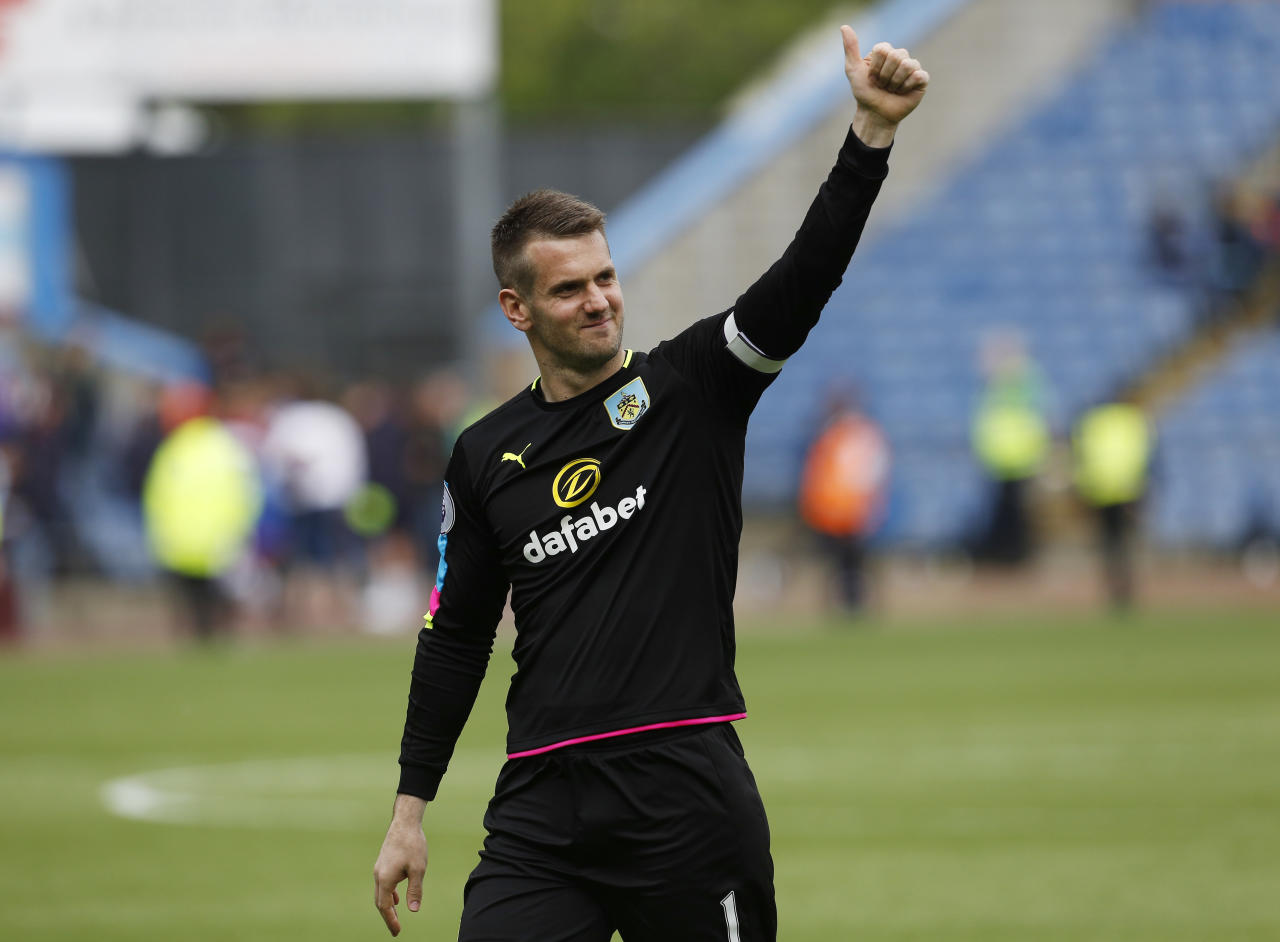 "Britain Football Soccer - Burnley v West Ham United - Premier League - Turf Moor - 21/5/17 Burnley's Tom Heaton gestures towards fans after the match Action Images via Reuters / Craig Brough Livepic EDITORIAL USE ONLY. No use with unauthorized audio, video, data, fixture lists, club/league logos or ""live"" services. Online in-match use limited to 45 images, no video emulation. No use in betting, games or single club/league/player publications.  Please contact your account representative for further details."