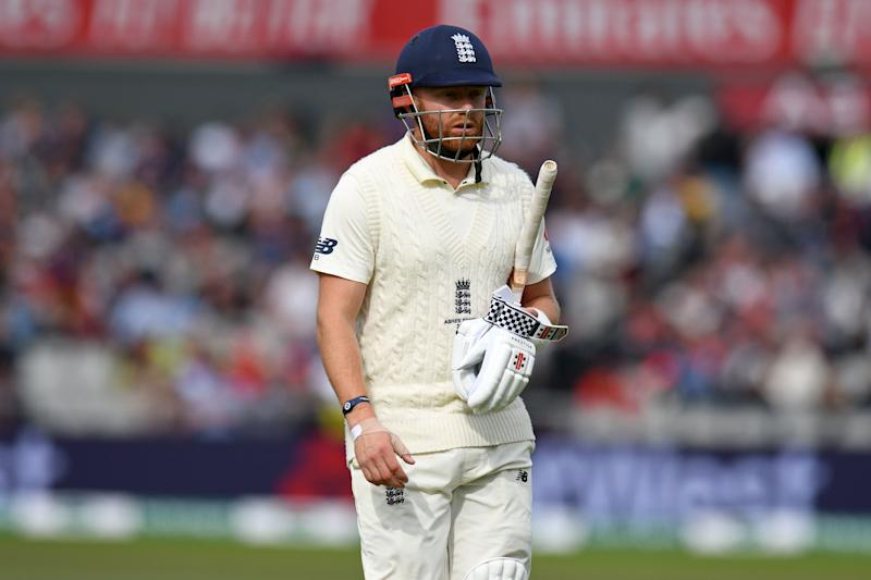 England's Jonny Bairstow reacts as he walks back to the pavilion after losing his wicket for 25 during play on the fifth day of the fourth Ashes cricket Test match between England and Australia at Old Trafford in Manchester, north-west England on September 8, 2019. (Photo by Oli SCARFF / AFP) / RESTRICTED TO EDITORIAL USE. NO ASSOCIATION WITH DIRECT COMPETITOR OF SPONSOR, PARTNER, OR SUPPLIER OF THE ECB (Photo credit should read OLI SCARFF/AFP/Getty Images)