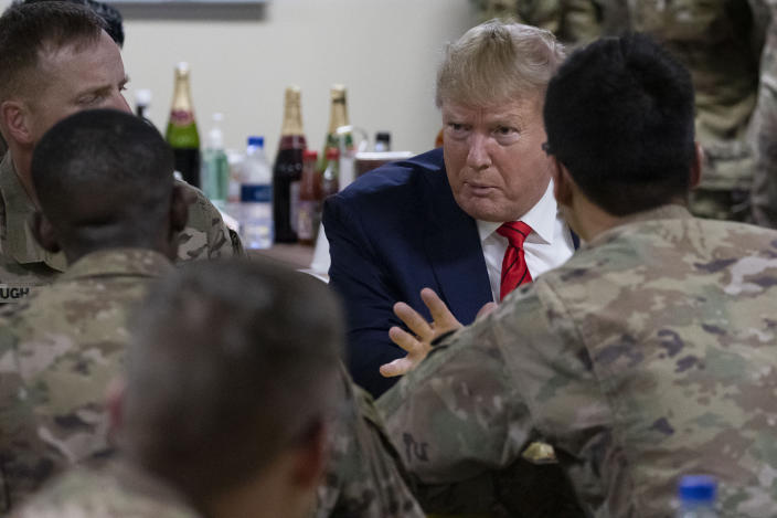 President Trump with members of the military in a dining facility during a surprise Thanksgiving Day visit to Afghanistan in 2019. (AP Photo/Alex Brandon)