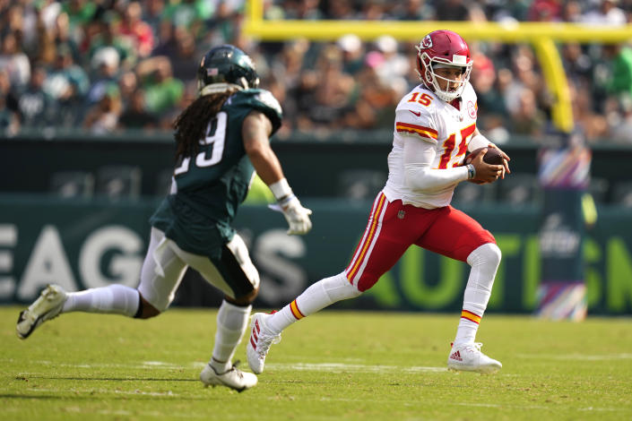 Kansas City Chiefs quarterback Patrick Mahomes (15) is chased by Philadelphia Eagles free safety Avonte Maddox (29) during the second half of an NFL football game Sunday, Oct. 3, 2021, in Philadelphia. (AP Photo/Matt Slocum)