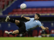 Uruguay's Luis Suarez takes a shot in an attempt to score during a Copa America soccer match against Argentina at the National Stadium in Brasilia Brazil, Friday, June 18, 2021. (AP Photo/Eraldo Peres)