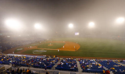 Florida and LSU play in the fog during the sixth inning of a Southeastern Conference tournament NCAA college baseball game Friday, May 25, 2018, in Hoover, Ala. The game was delayed. (AP Photo/Butch Dill)