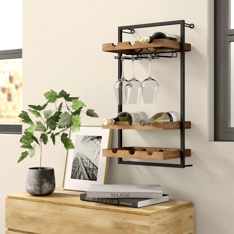 "<h3><a href=""https://www.wayfair.com/kitchen-tabletop/pdp/williston-forge-orla-9-bottle-wall-mounted-wine-bottle-and-glass-rack-w000148348.html"" rel=""nofollow noopener"" target=""_blank"" data-ylk=""slk:Orla 9 Bottle Wall Mounted Wine Rack"" class=""link rapid-noclick-resp"">Orla 9 Bottle Wall Mounted Wine Rack</a></h3><br><br><strong>When a bar cart is too big (but so is your booze collection): </strong>Try going with a wall-mounted bar instead that will display your bottles (and glasses) in elevated style.<br><br><strong>Williston Forge</strong> Orla 9 Bottle Wall Mounted Wine Bottle and Glass Rack, $, available at <a href=""https://go.skimresources.com/?id=30283X879131&url=https%3A%2F%2Fwww.wayfair.com%2Fkitchen-tabletop%2Fpdp%2Fwilliston-forge-orla-9-bottle-wall-mounted-wine-bottle-and-glass-rack-w000148348.html"" rel=""nofollow noopener"" target=""_blank"" data-ylk=""slk:Wayfair"" class=""link rapid-noclick-resp"">Wayfair</a>"