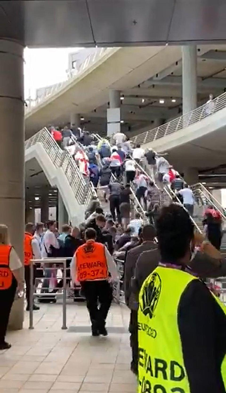 People running up steps as they try to force their way into Wembley Stadium (Michelle Owen/ITV Football/PA) (PA Media)