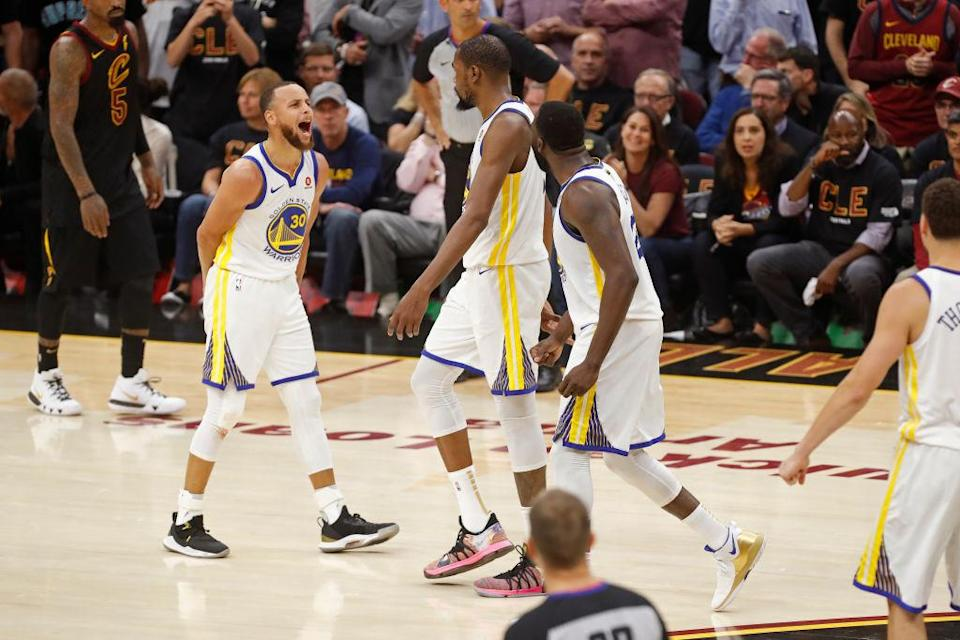 The Warriors celebrate as they moved within a victory of their third NBA title in four seasons. (Getty)