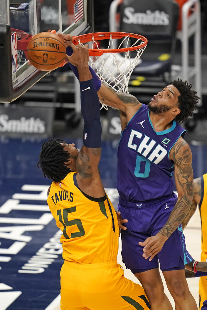 Charlotte Hornets forward Miles Bridges (0) blocks the shot from Utah Jazz center Derrick Favors (15) in the first half during an NBA basketball game Monday, Feb. 22, 2021, in Salt Lake City. (AP Photo/Rick Bowmer)