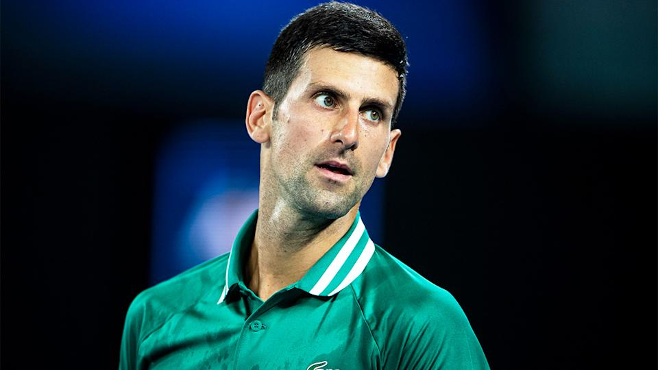 Novak Djokovic (pictured) looking at the player's box during the Australian Open.