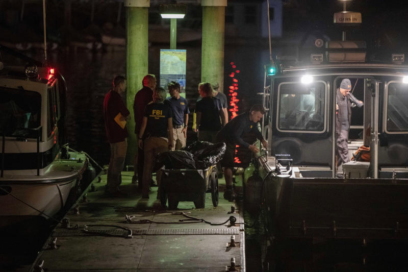 Authorities and FBI investigators cart away evidence taken from the scuba boat Conception in Santa Barbara Harbor at the end of their second day searching for the remaining divers still missing from the deadly pre-dawn fire on Sept. 3, 2019, in Santa Barbara, Calif. (Photo: Christian Monterrosa/AP)